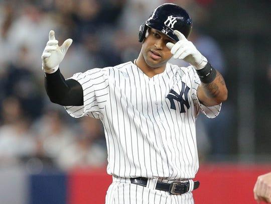 New York Yankees center fielder Aaron Hicks (31) reacts