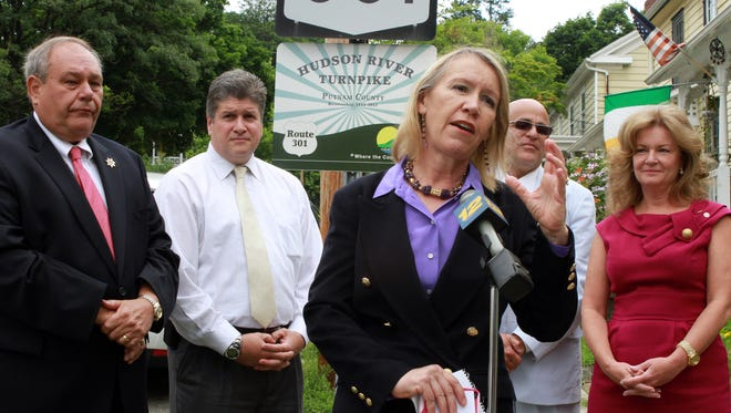 Putnam County Tourism Director Libby Pataki, center, speaks at the 2012 renaming of Route 301 to the Hudson River Turnpike from Carmel to Cold Spring. On the right is County Executive MaryEllen Odell.