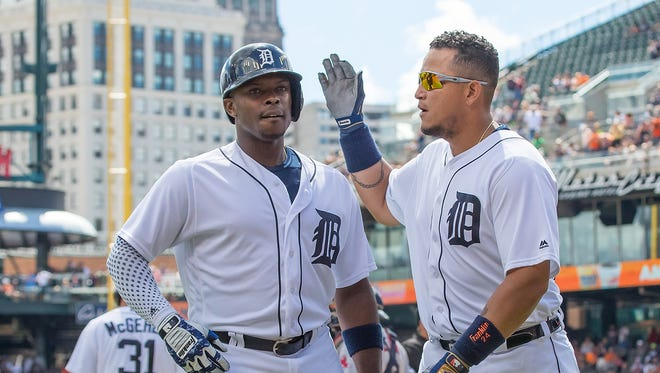 Tigers leftfielder Justin Upton celebrates hitting a three-run home run in the third inning with teammate Miguel Cabrera during the Tigers' 10-5 win Sunday at Comerica Park.