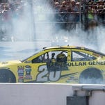 Matt Kenseth celebrates winning the New Hampshire 301 at the New Hampshire Motor Speedway in Loudon.