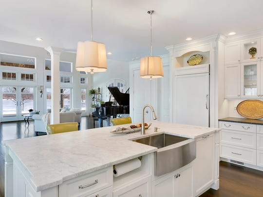 This bright white Design Line Kitchen in Sea Girt offers the perfect mix of modern and traditional elements.