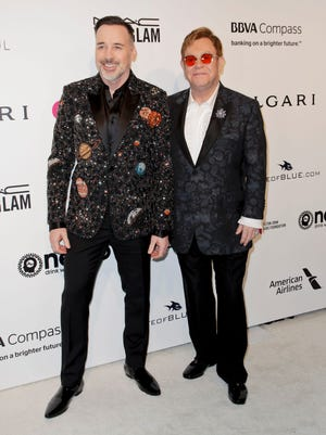 David Furnish  and Elton John arrive at their Oscars viewing party Feb. 26, 2017.