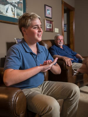 """Greg Yost listens as his 15-year-old neighbor Jack Menzies explains his CPR technique, which he credits to watching the TV show """"Scrubs, during an interview Wednesday, Aug. 23, 2017, in Pensacola."""
