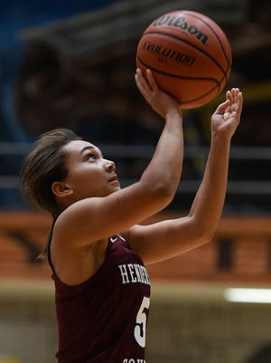 Henderson's Jaylee Carter (5) shoots as the Castle Knights play the Henderson County Lady Colonels at Castle Tuesday, December 5, 2017.