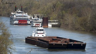 The Ingram Barge Co.'s HB Stewart, front, passes the General Jackson and another showboat as it travels toward Nashville on the Cumberland River on April 1, 2009.