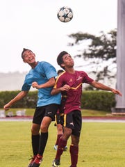 The Father Duenas Friars and Tiyan Titans face off with fancy footwork during their Independent Interscholastic Athletic Association boys soccer matchup at the LeoPalace Resort in Yona on Wednesday, Nov. 29, 2017.