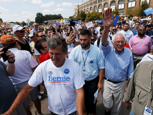 Democratic presidential candidate Bernie Sanders waves