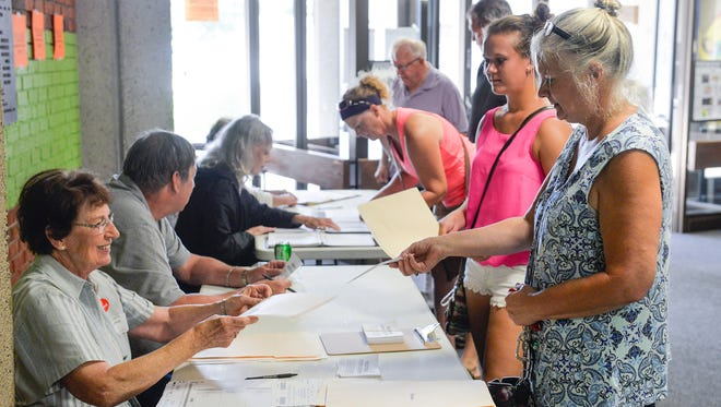 Voters line up to register and get their ballots for the primary election on Aug. 9 in Sauk Rapids Precinct 3 at Pleasantview Elementary School.