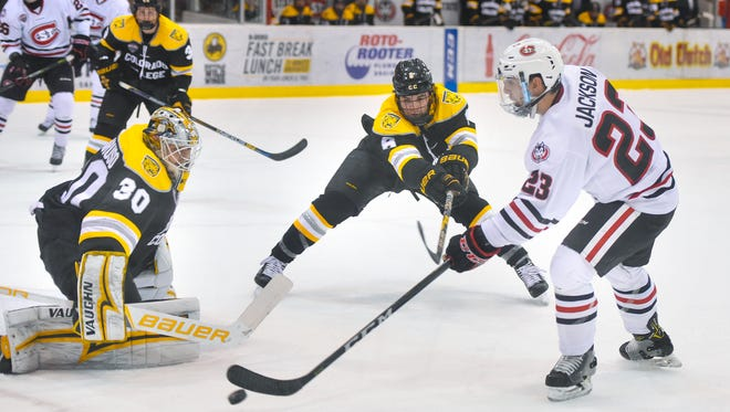St. Cloud State's Robby Jackson controls the puck near the Colorado College goal during the first period of the Friday, Nov. 17, game at the Herb Brooks National Hockey Center in St. Cloud.