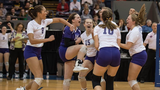 Bronson celebrates after a point during the MHSAA Class C Volleyball Championships at Kellogg Arena on Nov. 18, 2017.