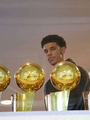 Lonzo Ball of the Los Angeles Lakers arrives for a press conference after he was selected as the No. 2 pick in the NBA draft.
