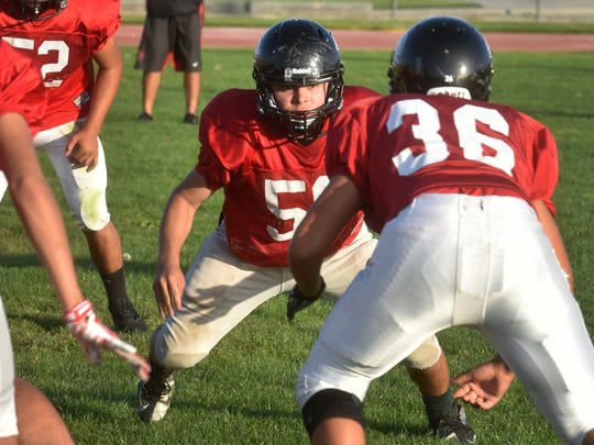 Cristian Castellanos (center) may be just 5-foot-7, but he is a force on the line for Rio Mesa.