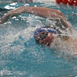 Seven Hills sophomore Henry Marquardt swims in the boys 200 yard freestyle Feb. 20 at Miami in the Division II district swim meet.