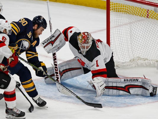 A shot by Buffalo Sabres forward Ryan O'Reilly (90) is stopped by New Jersey Devils goalie Keith Kinkaid (1) during the third period of an NHL hockey game, Tuesday, Jan. 30, 2018, in Buffalo, N.Y. (AP Photo/Jeffrey T. Barnes)