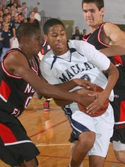 Maclay's Seth Roberts gets fouled by North Florida Christian's Michael Railey (00) on a drive to the basket during a game on Jan. 16, 2009. Roberts had 17 points as Maclay won 61-38.