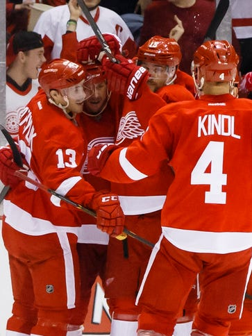 Pavel Datsyuk (13) scored twice as the Red Wings won