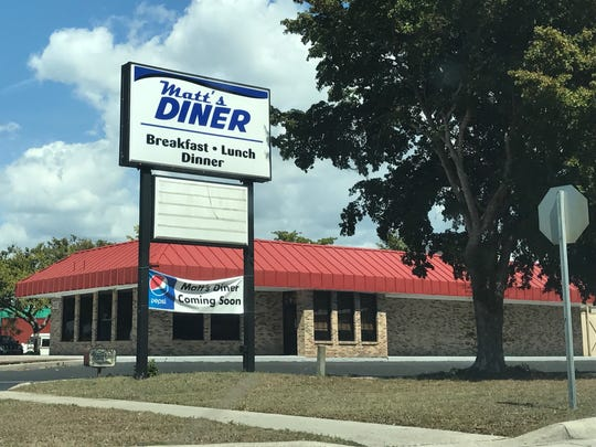Signs are up for Matt's Diner  on Fowler Street in