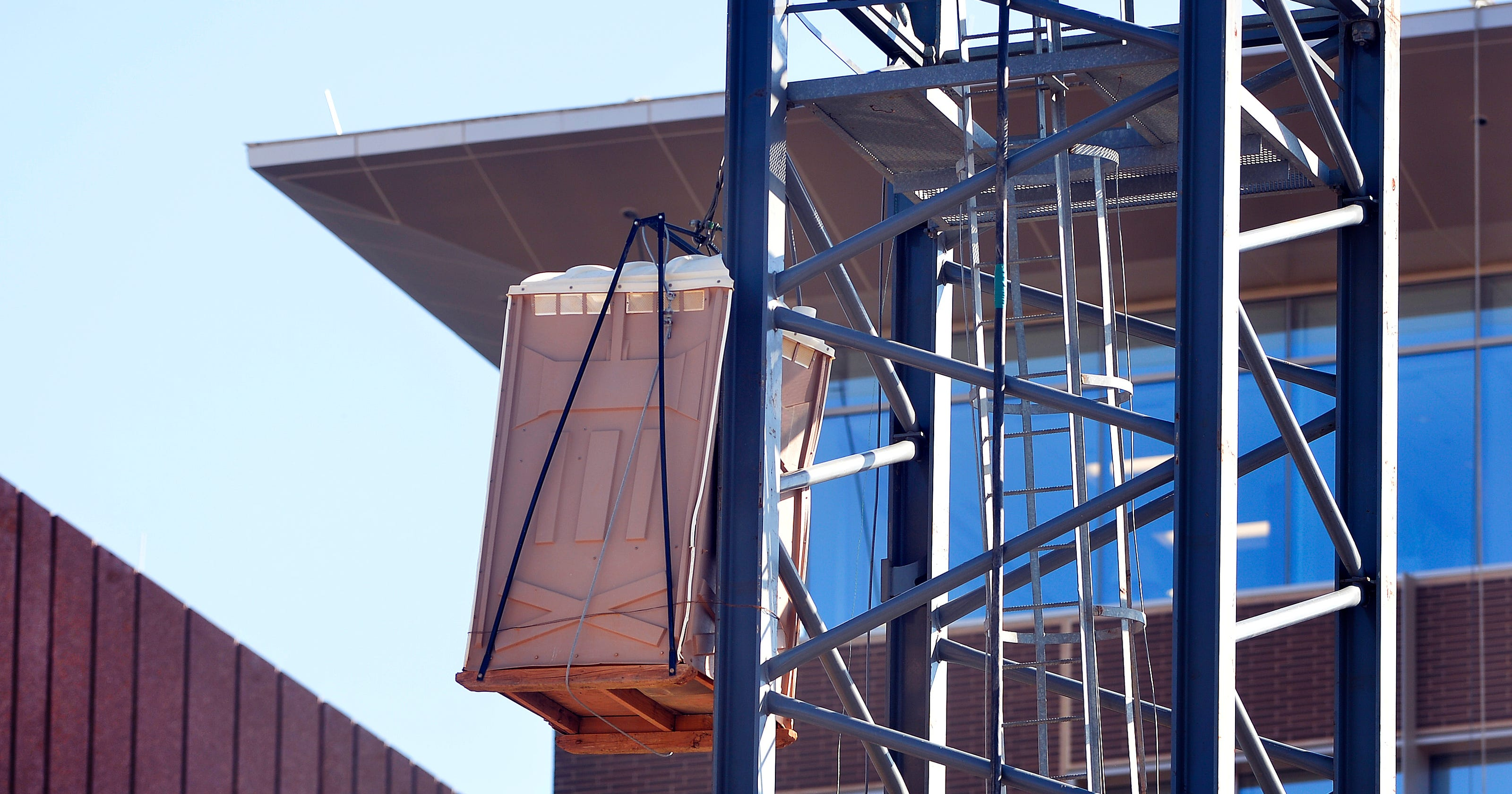 Q&Amy: Why is there a portable toilet hanging from a crane?