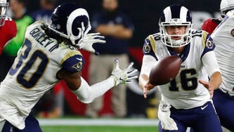 Rams quarterback Jared Goff (16) pitches the ball to running back Todd Gurley against the Arizona Cardinals last Sunday. Gurley is second in the NFL with 939 yards rushing.
