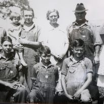 An old portrait of Cecil Denton, center of bottom row, and his family taken well before Denton went into the Army. Denton and his four brothers all served during World War II.