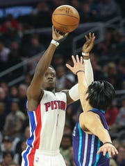 Pistons guard Reggie Jackson scores the Hornets' Jeremy Lin during the second period on March 25 at the Palace.
