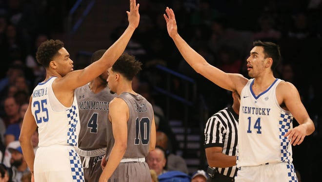 Kentucky Wildcats forward PJ Washington (25) and forward Tai Wynyard (14) react in the first half against Monmouth Hawks at Madison Square Garden.