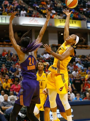 Indiana Fever guard Briann January (20) gets a shot over Phoenix Mercury guard DeWanna Bonner (24) at Bankers Life Fieldhouse on Sept. 21, 2016.
