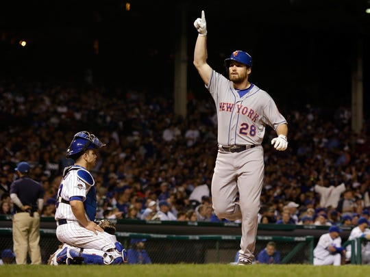 CHICAGO, IL - OCTOBER 20: Daniel Murphy #28 of the New York Mets celebrates after hitting a solo home run in the third inning against Kyle Hendricks #28 of the Chicago Cubs during game three of the 2015 MLB National League Championship Series at Wrigley Field on October 20, 2015 in Chicago, Illinois. (Photo by David J. Phillip - Pool/Getty Images) *** BESTPIX ***