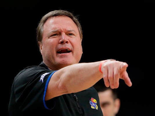 Kansas head coach Bill Self directs his team during a practice session for the Final Four NCAA college basketball tournament, Friday, March 30, 2018, in San Antonio. (AP Photo/Eric Gay)