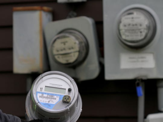 A DTE smart meter being is installed at a home in 2011.
