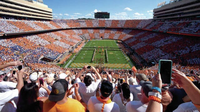 The University of Tennessee football team takes the field as the Pride of the Southland marching band performs a pregame show and fans checker Neyland Stadium orange and white.
