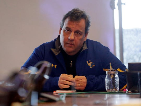 New Jersey Gov. Chris Christie wears a University of Delaware jacket as he listens to a briefing Jan. 23 in Woodbridge, N.J on the recent snowstorm.