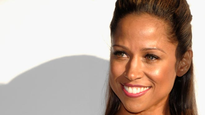 FILE - In this Sunday, March 7, 2010, file photo Stacey Dash arrives at the Elton John Oscar Party in West Hollywood, Calif. Dash, who tweeted an endorsement of Romney, was subjected to a stream of abuse from other African-Americans.  (AP Photo/Dan Steinberg) ORG XMIT: WX104