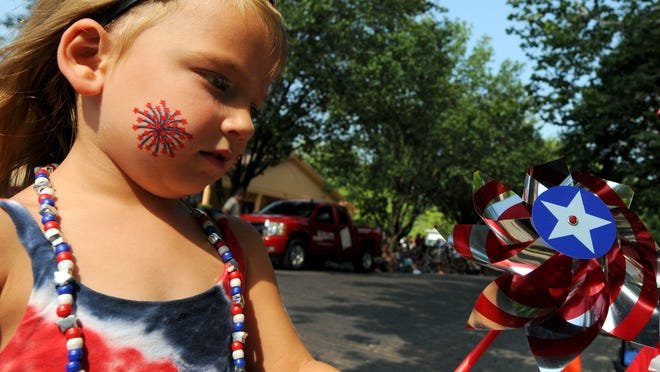 Emerson Morris, 4, Noblesville, was in the spirit of the holiday as she waited for the parade to begin. Hundreds of parade fans lined the streets of Noblesville Sunday, July 4, 2010, to watch the annual Fourth of July parade. The parade featured a variety of units to entertain the masses. (Doug McSchooler/for The Star)