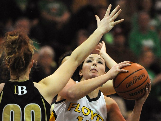 Floyd Central's Madison Kaiser (right) shoots around Indianapolis' Dani Brewer (left) on Friday at Floyd Central High School. Dec. 27, 2013