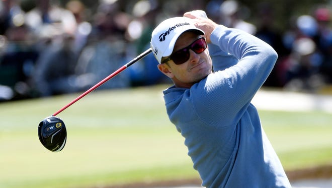 Justin Rose hits his tee shot on the 3rd hole during the third round of the Masters at Augusta National Golf Club.