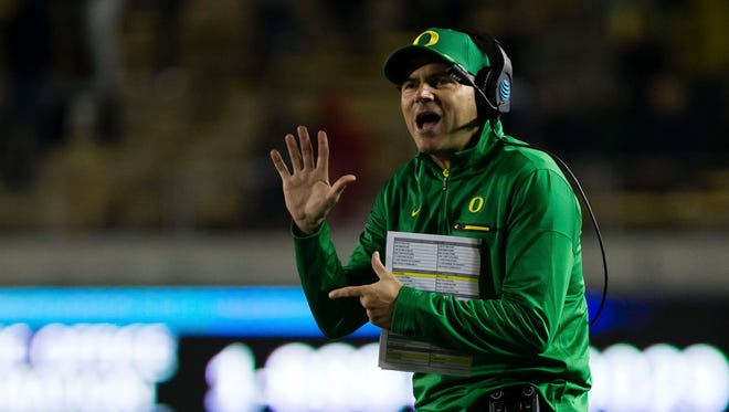 Oct 21, 2016; Berkeley, CA, USA; Oregon Ducks head coach Mark Helfrich calls out from the sideline against the California Golden Bears during overtime at Memorial Stadium. The California Golden Bears defeated the Oregon Ducks 52-49 in overtime. Mandatory Credit: Kelley L Cox-USA TODAY Sports
