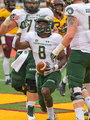 CSU's Detrich Clark celebrates after running for a touchdown last season in a Sept. 24 game at Minnesota. Clark scored four touchdowns in a limited role last season but hopes to become an every-down player for the Rams this fall.