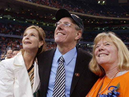 Syracuse head coach Jim Boeheim, center, celebrates the Orangemen 81-78 victory over the Kansas Jayhawks with his wife Julie, left, and sister Barbara following their NCAA Championship.