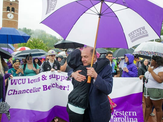 Chancellor David Belcher gets a hug during a rally April 22 at Western Carolina University. Belcher notified the campus earlier that week that he has been diagnosed with a brain tumor.