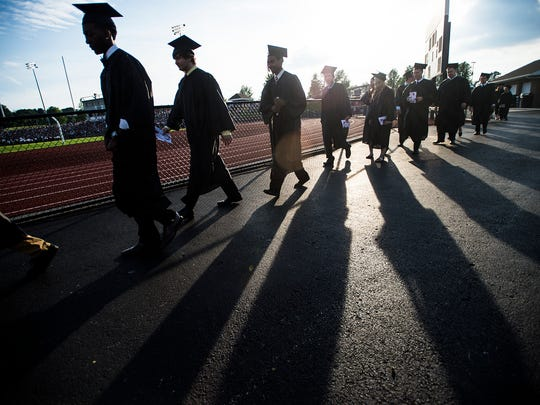 South Western High School seniors head to the beginning of their graduation ceremony in 2015.