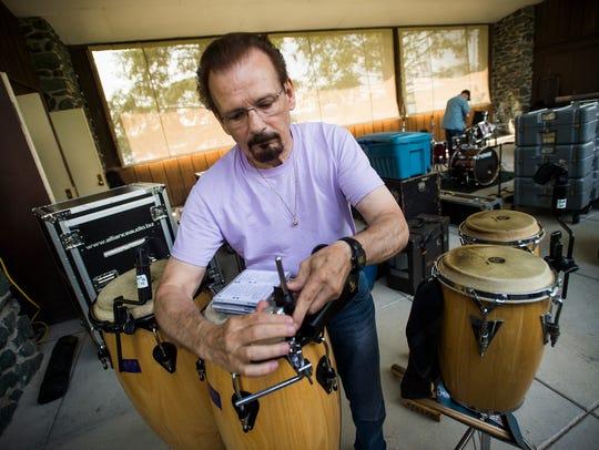 Jim Colestock, prepares his percussion instruments