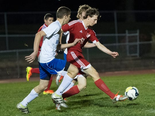 Fannett-Metal's Mikell McGee (11) advances past Windber's defense and takes a shot to score a goal during the District 5 Class 1A boys soccer championship at Northern Bedford High School in Loysburg, Pa. on Thursday, Nov. 3, 2016. Windber defeated the Tigers, 3-2.