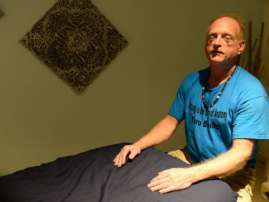 Tommy Gibson, who is legally blind, has been a massage