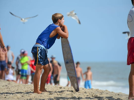 Jack Lee, Rehoboth, waits for the perfect wave during his heat in the semifinals of the Skim USA Association ZAP Pro/Am Skimboarding Competition in Dewey Beach, De. on Friday, August 11, 2017.