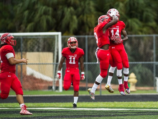 Immokalee High School celebrates a touchdown during