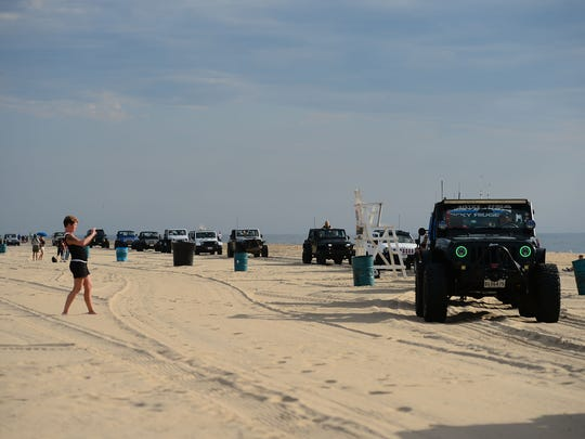 Jeep's flood the beach during the 2017 Jeep Week in Ocean City, Md. Friday, August 25, 2017.