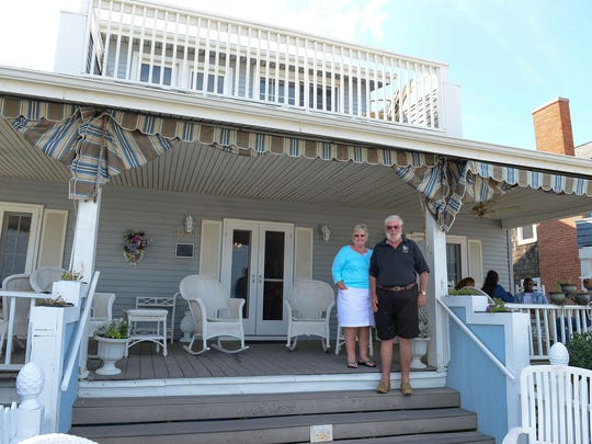 Vicki and Charlie Barrett, Owners of The Inn on the Ocean, stand on the porch of their business that is located on 10th street and The Boardwalk on Wednesday, August 30, 2017.