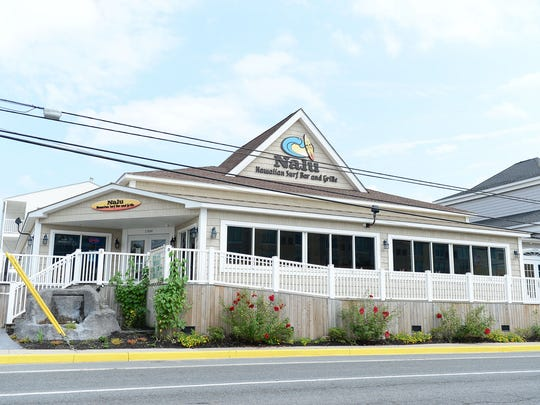Nalu Hawaiian Surf Bar & Grill in Dewey Beach will expand with a new patio filled with palm trees, waterfalls, surfboards and tiki huts.