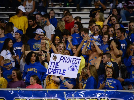 Sussex Central's fans cheer on their team during the